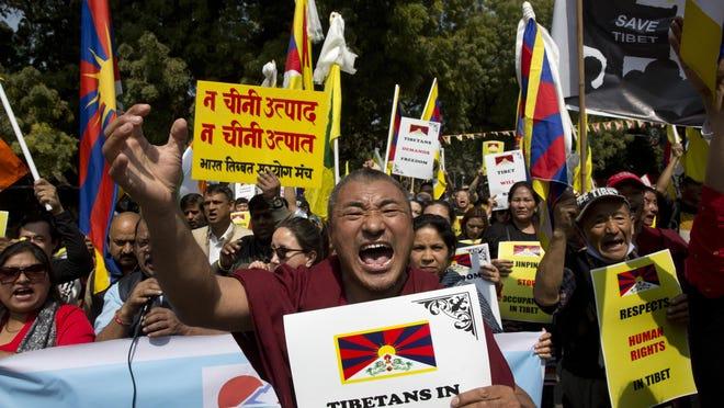 China attacks Dalai Lama, defends Tibet rule 60 years after uprising
