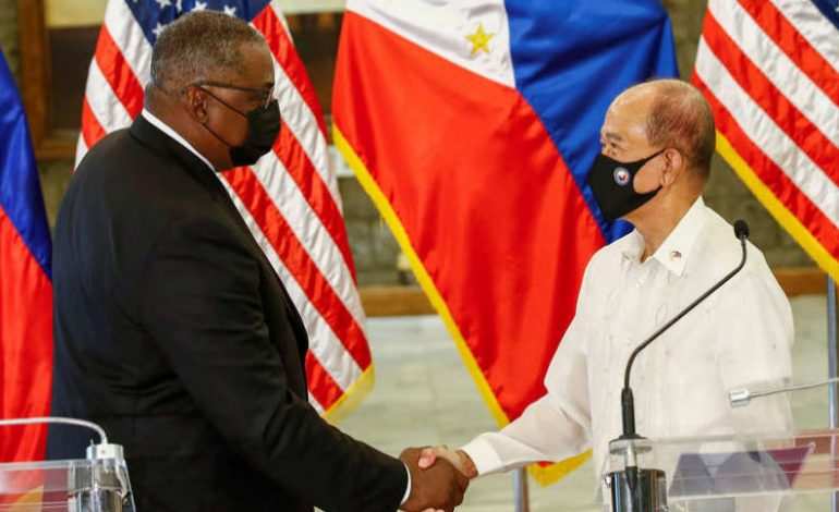 Philippines defense chief says was urged by China to drop review of U.S. pact